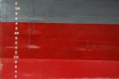 Water Depth Markings on Ship Hull. Water Depth markings on red and gray ship hull Royalty Free Stock Photo