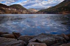 Depth view of iced  lake baselga di pine  italy Royalty Free Stock Photo