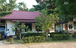 In the depths of the Thai jungle lie a few modern dwellings stock photo