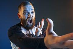 Der Ärger und der schreiende Mann Lizenzfreies Stockfoto