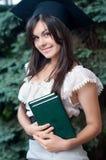 Der Absolvent mit der quadratischen akademischen Schutzkappe Stockfoto
