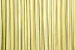 Der abstrakte strukturierte Hintergrund der gelben Farbe Lizenzfreies Stockfoto