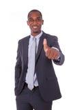 Der AfroamerikanerGeschäftsmann, der Daumen herstellt, up Geste über whi Lizenzfreies Stockfoto