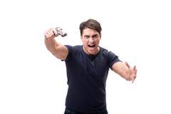Der aggressive junge Mann mit dem Gewehr lokalisiert auf Weiß Stockbild