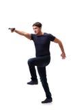 Der aggressive junge Mann mit dem Gewehr lokalisiert auf Weiß Lizenzfreie Stockfotos