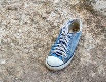 Der alte Schuh auf Boden Lizenzfreie Stockfotos