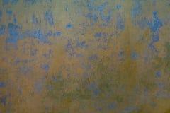 Der alte und alte Gips einer Wand Stockfoto