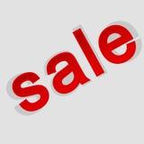 Der Aufschriftverkauf auf einem grauen Hintergrund mit Schatten Lizenzfreie Stockfotos