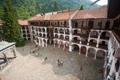 Der Auftritt von klösterlichen Zellen im Rila-Kloster in Bulgarien Lizenzfreies Stockfoto