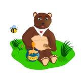 Der Bär mit Honig Lizenzfreie Stockbilder