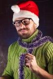 Der bärtige Mann im roten Weihnachtshut Santa Claus, Lizenzfreie Stockfotografie