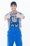 Der überzeugte Klempner, der Daumen zeigt, up Zeichen Lizenzfreies Stockfoto