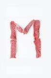 Der Buchstabe M auf einem weißen Hintergrund Lizenzfreie Stockfotografie