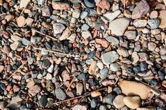 Der bunte Hintergrund von Steinen Stockfotografie