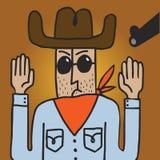 Der Cowboy, der durch eine Waffe gezielt wird, hebt seine Hände an Lizenzfreie Stockfotos