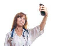 Der Doktor tut das selfie Stockfotos
