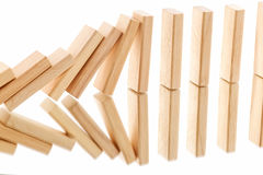 Der Domino-Effekt in der Aktion Stockbilder