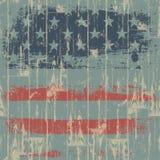 Der Druck der amerikanischen Flagge gegen eine hölzerne Wand. Lizenzfreie Stockbilder