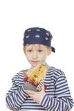 Der durchdachte Junge mit Spielzeuglieferung. Stockfoto