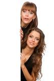 Der Einfluss mit zwei Frauen in ihren Händen säubern Plakat stockfoto