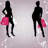 Der Entwurf von zwei modernen Mädchen mit dem Einkaufen Lizenzfreies Stockfoto