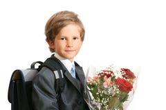 Der First-grader mit einem Blumenstrauß Lizenzfreie Stockbilder