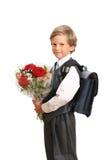 Der First-grader mit einem Blumenstrauß Lizenzfreies Stockfoto