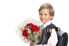 Der First-grader mit einem Blumenstrauß Stockfoto