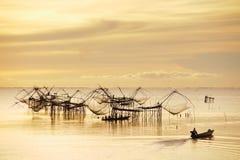 Der Fischer im Sonnenaufgang Stockfoto