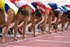 Der Frauen 100 Meter Rennen- Stockfotografie