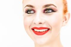 Der Frauenabschluß, der oben gerade schauen und Lächeln Stockfoto