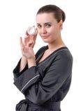 Der Gebrauch der Kosmetik für Hautpflege Stockfotos