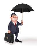 Der Geschäftsmann auf der Straße unter einem Regenschirm. Lizenzfreies Stockbild