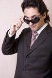Der Geschäftsmann in den Sonnenbrillen Stockfotos
