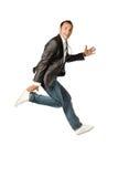 Der Geschäftsmann, der auf einen weißen Hintergrund springt Lizenzfreie Stockfotos