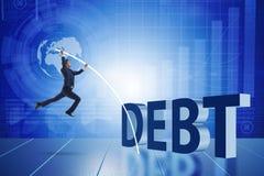 Der Geschäftsmann, der Schuldenlast im Geschäftskonzept vermeidet lizenzfreie stockbilder
