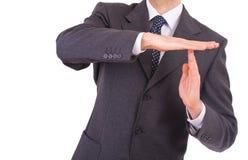 Der Geschäftsmann, der Zeit heraus zeigt, unterzeichnen mit den Händen. Stockbilder