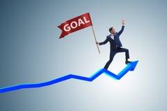 Der Geschäftsmann, der seine Unternehmensziele und Ziele erzielt Stockbild