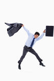 Der Geschäftsmann springend beim Anhalten seiner Jacke Lizenzfreies Stockfoto