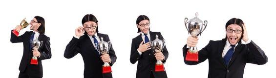 Der Geschäftsmann zugesprochen mit der prize Schale lokalisiert auf Weiß Stockfotografie