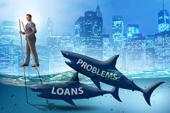 Der Gesch?ftsmann, der erfolgreich Darlehen und Schulden besch?ftigt lizenzfreies stockfoto