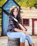 Der Gott des Cowgirls ein Gewehr Stockbild