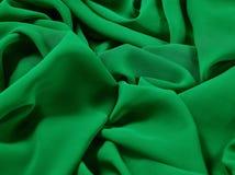 Der grüne abstrakte Stoff, der Gewebehintergrund und die Beschaffenheit, Vorhangtheater Stockfotografie