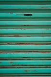 Der grüne Hintergrund machte Metall Stockfotos