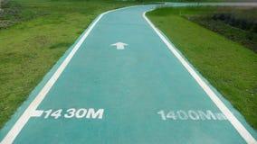 Der grüne Weg für das Laufen und das Gehen Stockfotografie