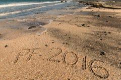 Der Gruß des neuen Jahres im Sand Stockfoto