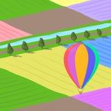 Der Heißluftballon, der über multi farbige Blumenfelder fliegt, gestalten landschaftlich, übergeben gezogene Illustration des Vek Lizenzfreie Stockbilder