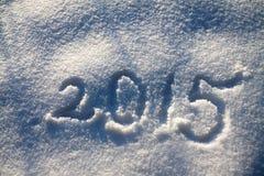 Der hintergrund des neuen Jahres und Weihnachtsvom Schnee und von der Zahl Stockbild