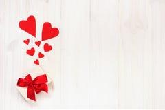 Der Hintergrund des Valentinsgrußes mit Stockbild