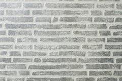 Der Hintergrund, in Form eines grauen Ziegelsteines, ist für die Werbung, Texteinfügung passend Lizenzfreie Stockfotografie